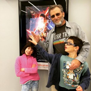 Dr. Watenpaugh debates the finer points of Trek vs. Star Wars with his son, Aram, while his daughter looks on in appropriate bemusement